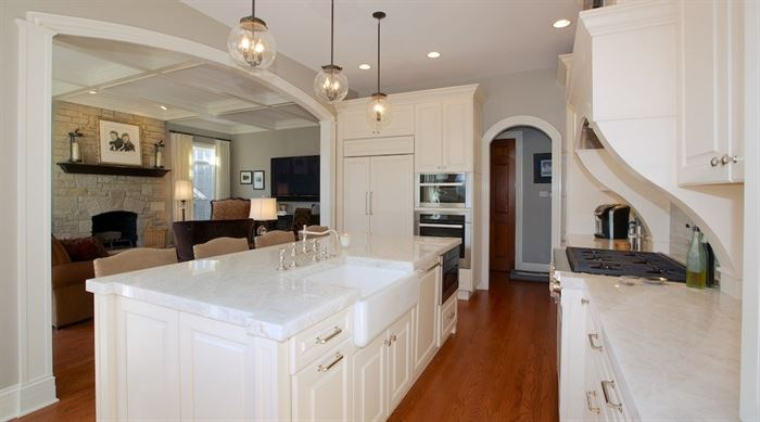 Hinsdale kitchen renovation featuring white cabinets and countertops and a coffered ceiling