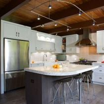 Kitchen design with white cabinets and counter tops with gray floor and island
