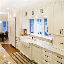 Kitchen remodel with white cabinets and brown floor