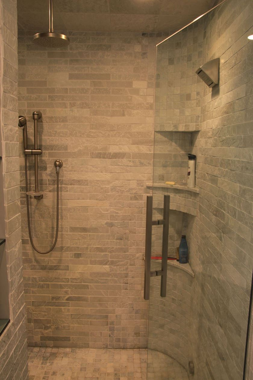 Bathroom renovation with beige tile shower