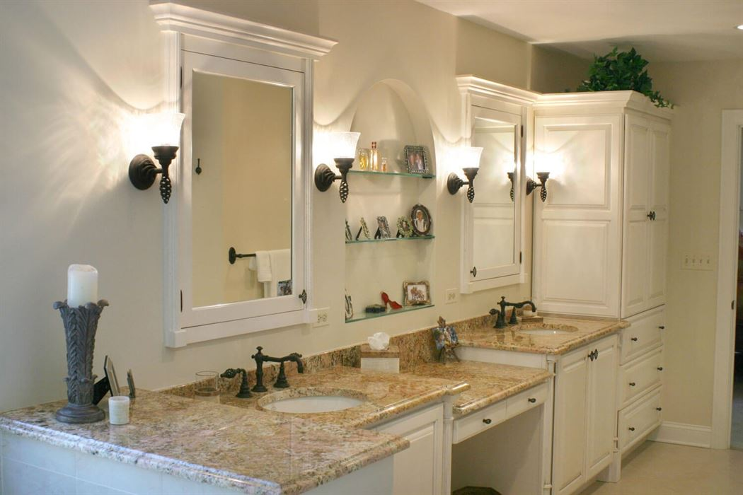 Bathroom renovation with white floor cabinets and walls with brown counter tops