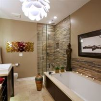 Redesigned bathroom with beige tile floor and walls with white tub and sinks