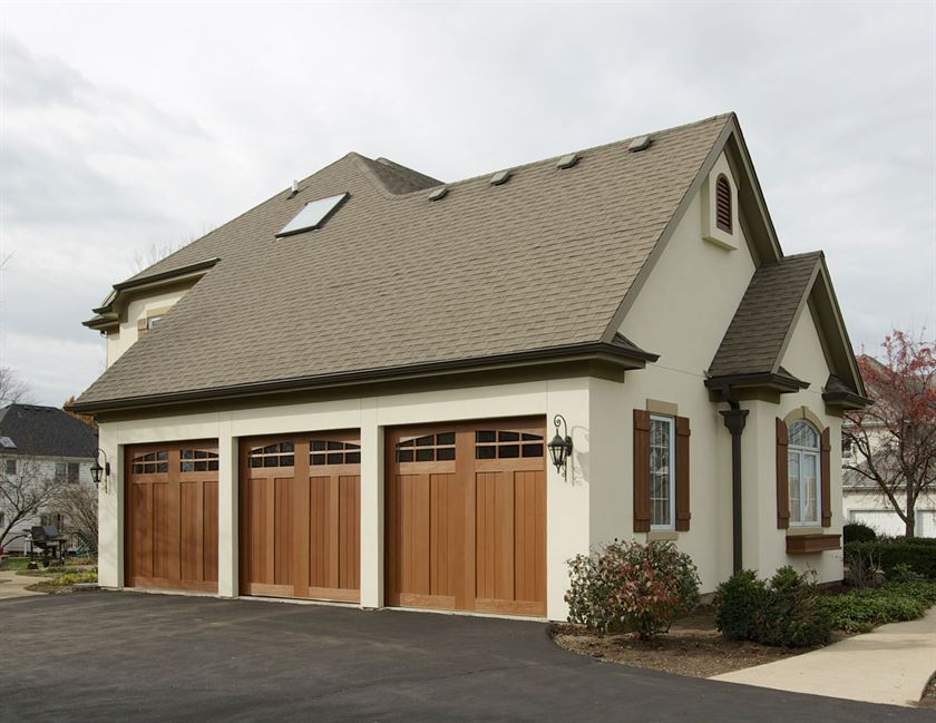Home renovation with brown garage door, white stucco