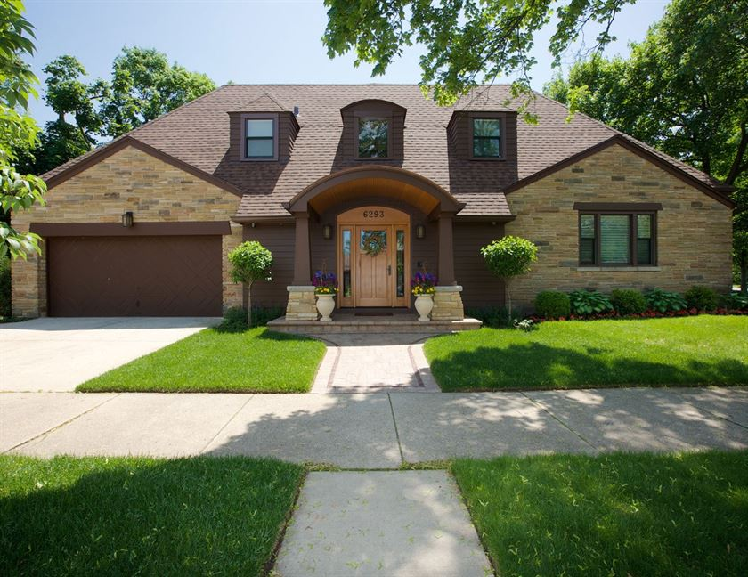 Home renovation with brick patio, brown wood finish, brown wood paneling