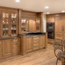 Remodeled Kitchen with brown island wood floor and brown cabinets