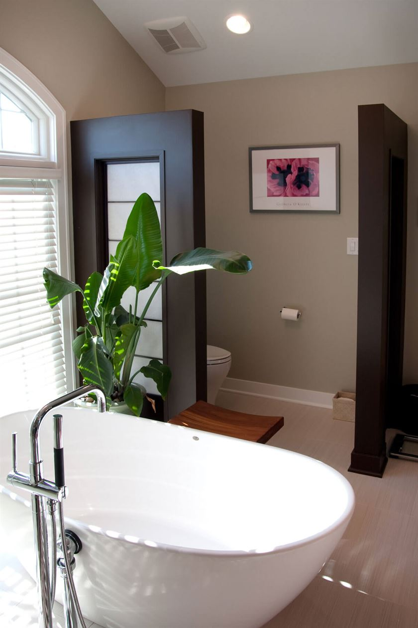 Bathroom redesign with gray walls and floor with white tub