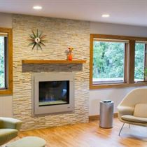 Living room design with brown floor white walls and brick fireplace