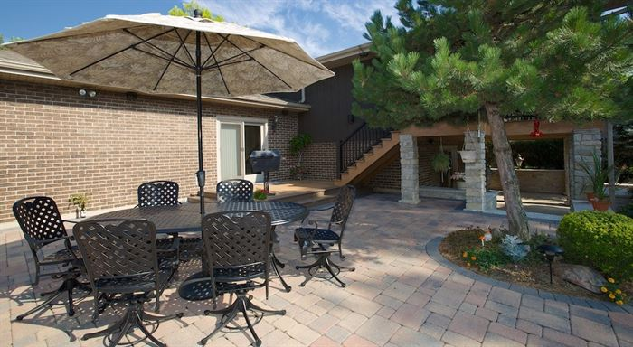 Backyard patio with table and umbrella