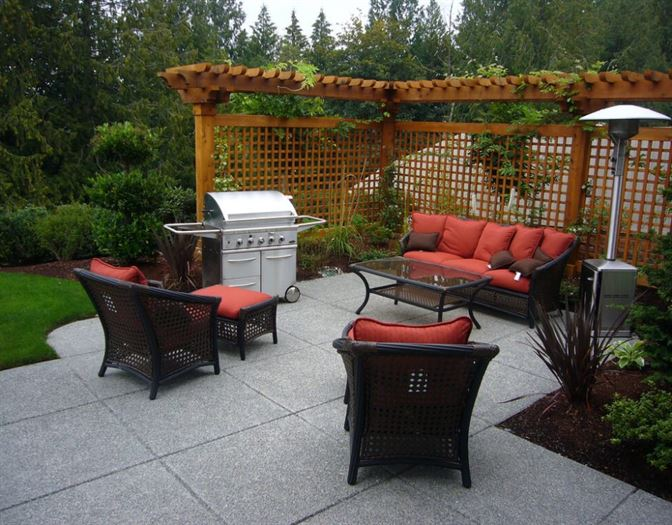 Patio design with gray concrete patio and brown wood enclosure