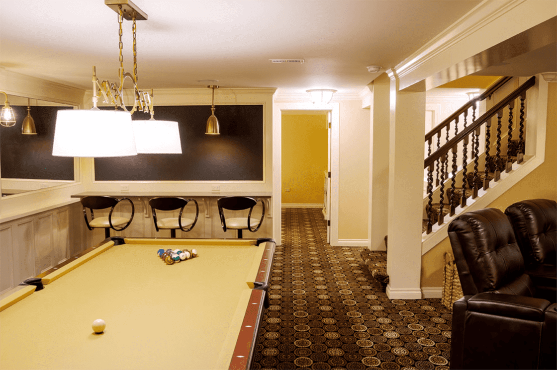 Basement remodel with bar area and pool table