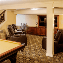 Basement remodel with beige walls and ceiling with brown cabinets