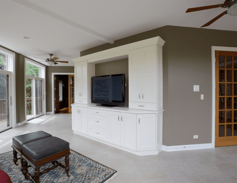 Living Room design with white carpet, ceiling and entertainment center and gray walls