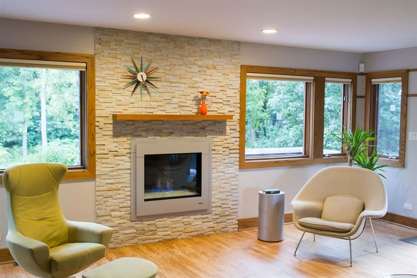 room remodeling with wood flooring white walls and fireplace