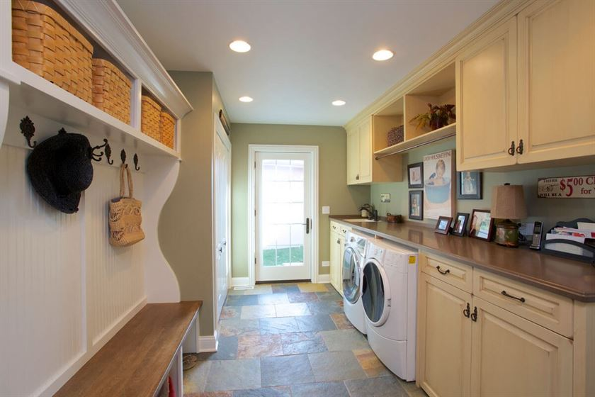 Mudroom and laundry room renovation with colorful tile flooring