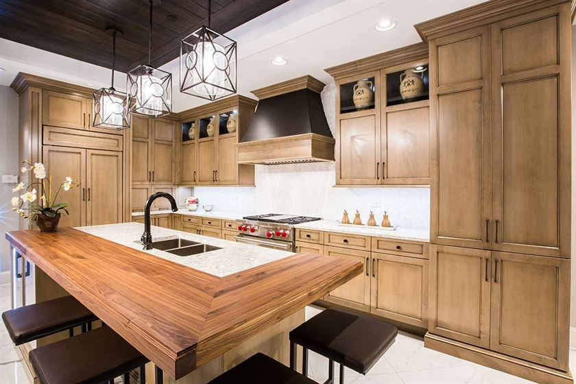 kitchen remodeling white flooring and walls with brown island and cabinets