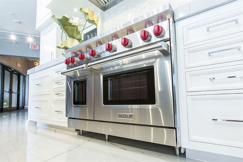 kitchen remodeling stainless steel over and white cabinets