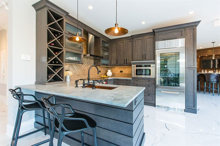 kitchen remodeling with white flooring counter tops and brown cabinets