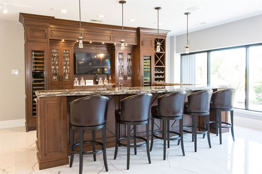 kitchen remodeling white flooring and brown cabinets and island