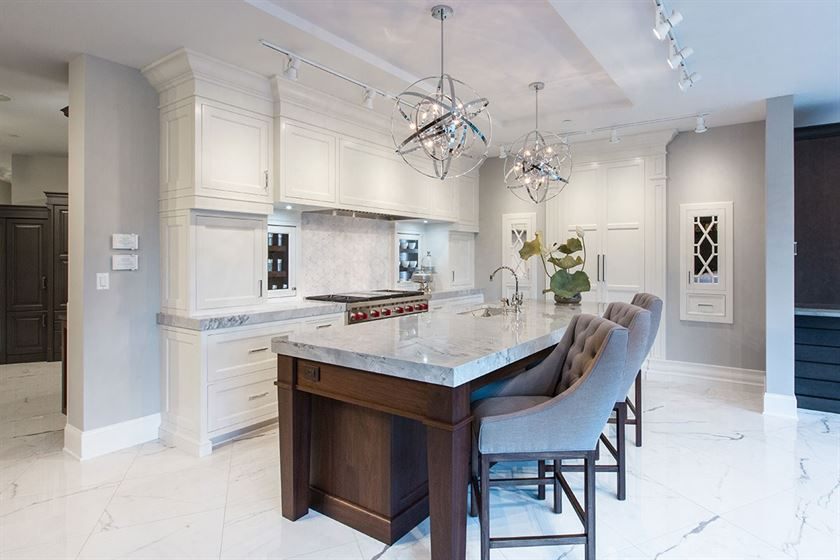 kitchen remodeling with white flooring cabinets counter tops and brown island