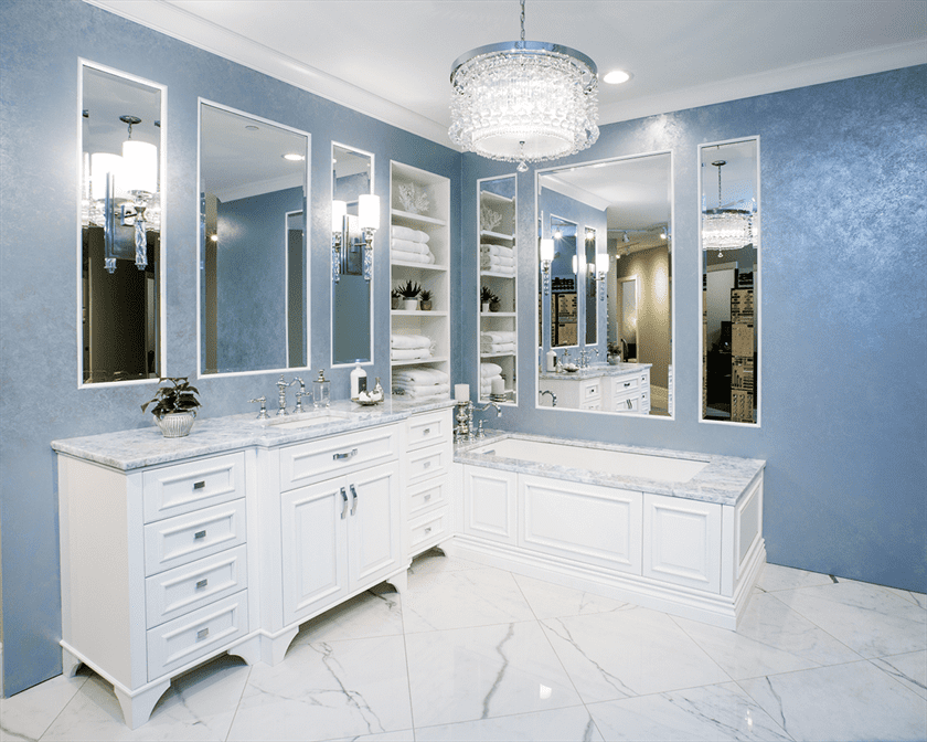 bathroom remodeling white flooring cabinets tub and blue walls with mirrors