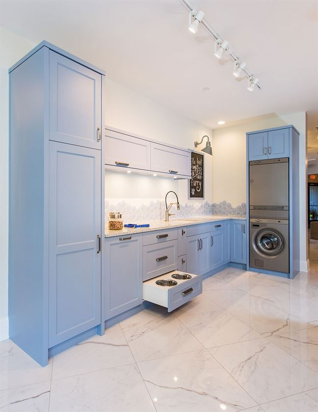 home remodeling with white floors and walls with blue cabinets