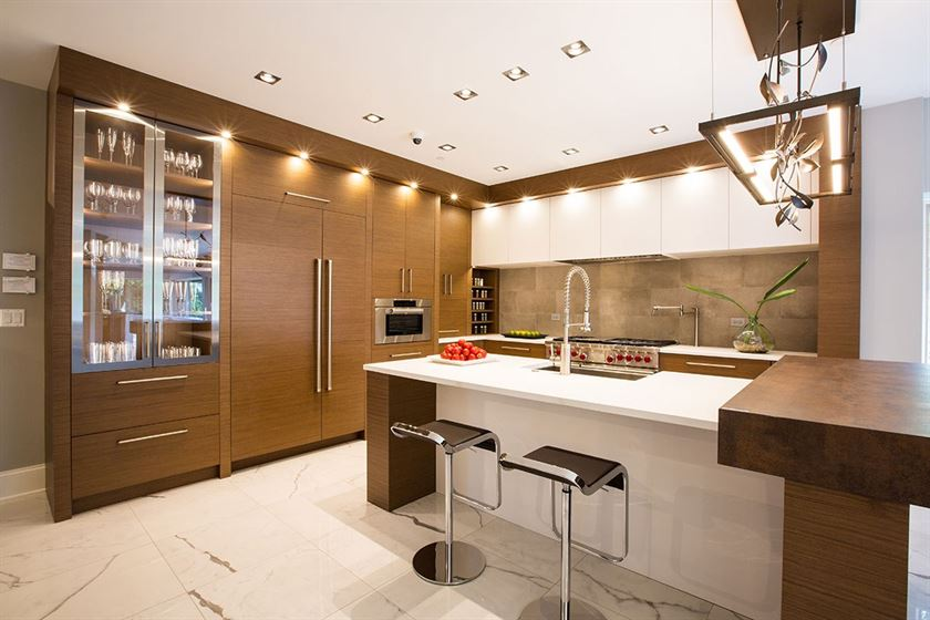 kitchen remodeling white floors counter tops and brown cabinets