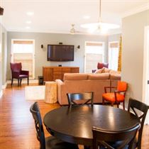 open concept brown flooring with blue walls and white ceiling
