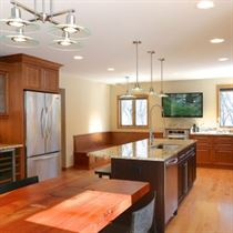 kitchen remodeling brown flooring cabinets and island with white walls and ceiling