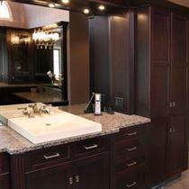 beige counter tops and floor with brown cabinets and white sink