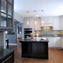 kitchen remodeling brown floor with white and black cabinets