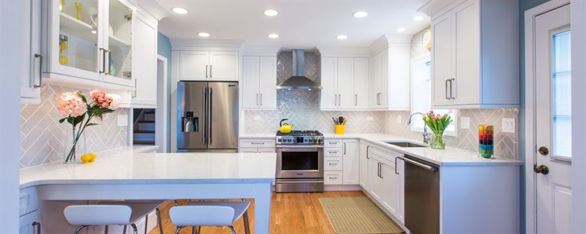 Kitchen remodeling Arlington Heights white table cabinets counter tops and stainless steel refrigerator oven dishwasher