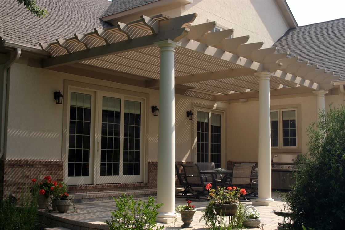 Exterior renovation in backyard patio with pergola