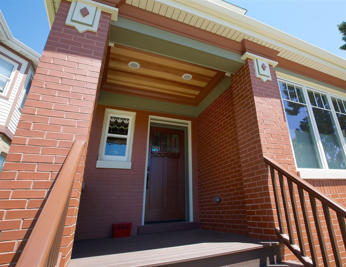 Exterior renovation to entryway of a brick bungalow home