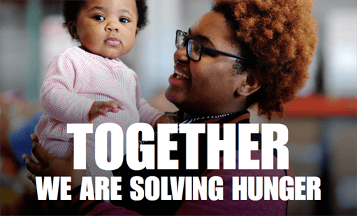 Parent holding child with the words together we are solving hunger