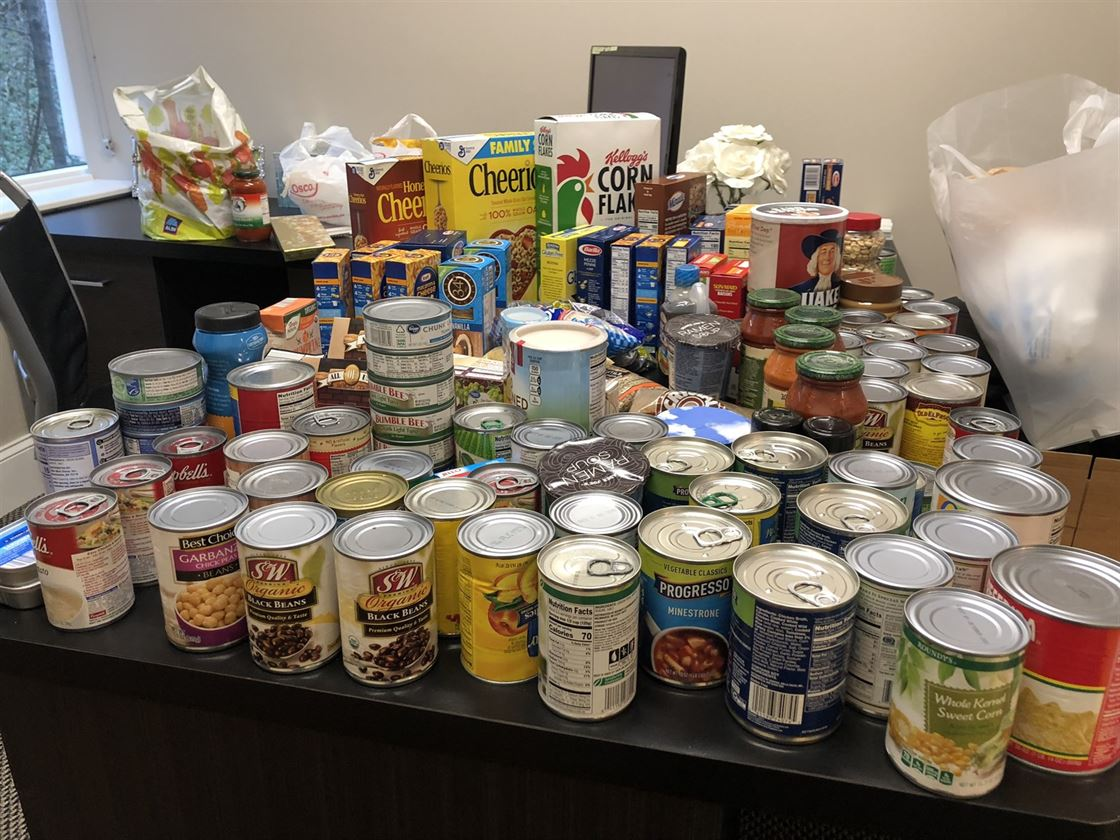 Non-perishable food items on a desk collected for the Northern Illinois Food Bank