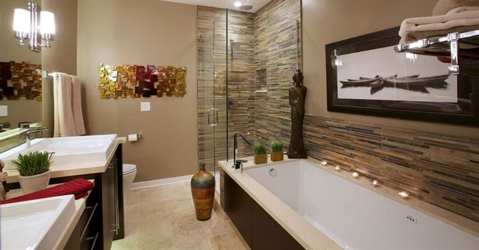 Spa bathroom in brown tones with separate bath and shower