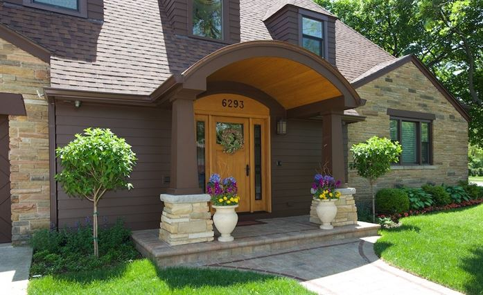 Front door of home with arched dormer