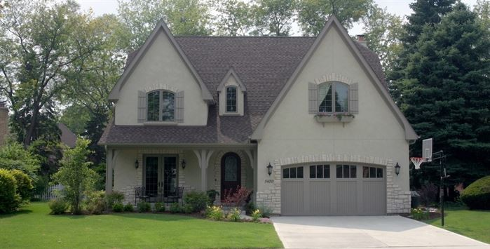 Front of home with gray roof and great curb appeal