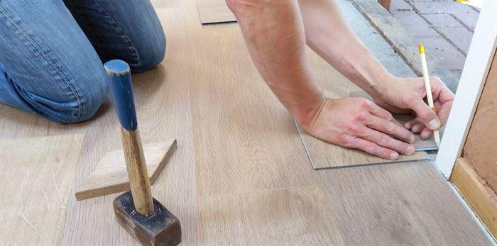 Worker installing new flooring