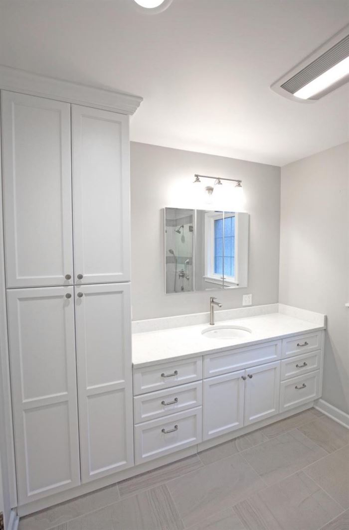 Renovated bathroom with floor to ceiling storage