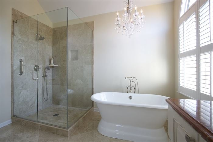 Stand-alone tub and walk-in shower in bathroom