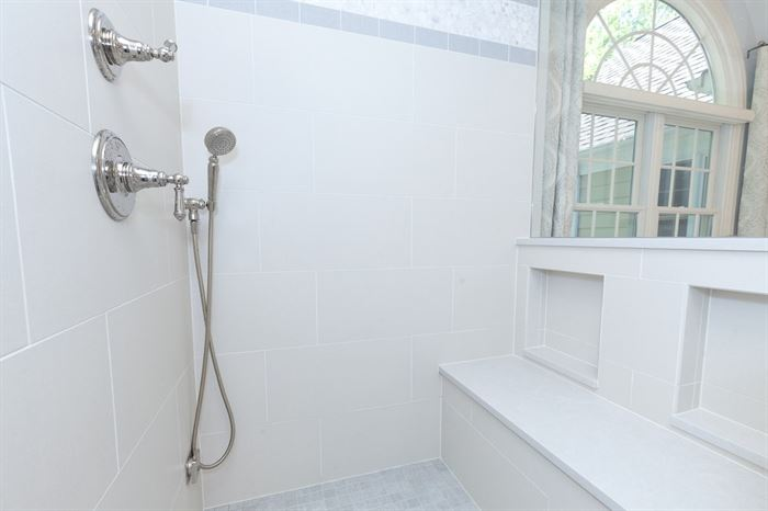Walkin shower with handheld showerhead and bench