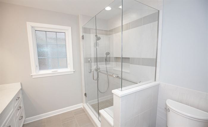 Bathroom with walk-in shower and framleess shower doors