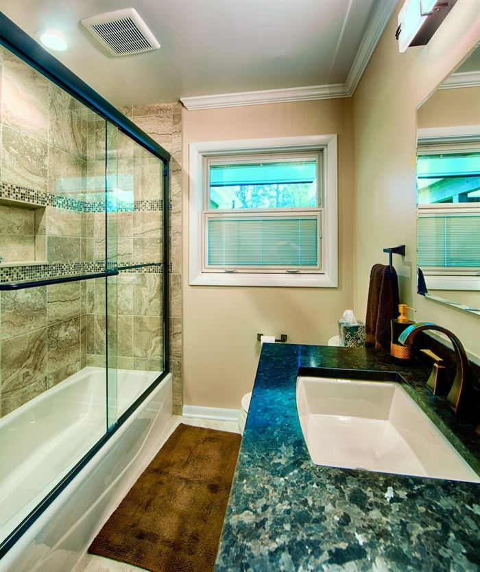 Bathroom with framed shower doors and tub/shower combo