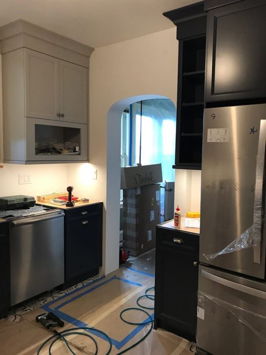 Installation of new stainless steel appliances in kitchen remodel