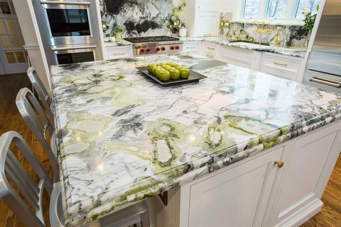 Renovated kitchen with green marbled granite