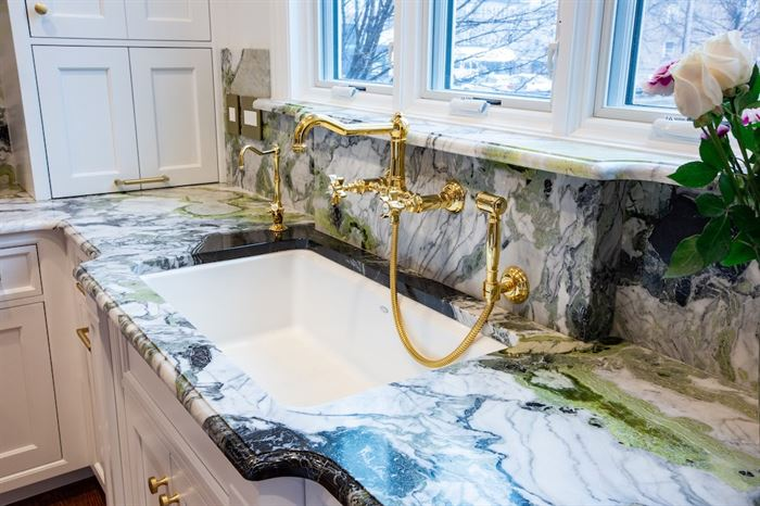 Renovated Forest Park kitchen sink with gold fixtures