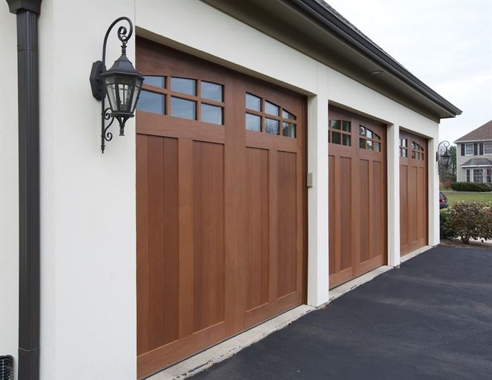 Wood garage doors on white garage