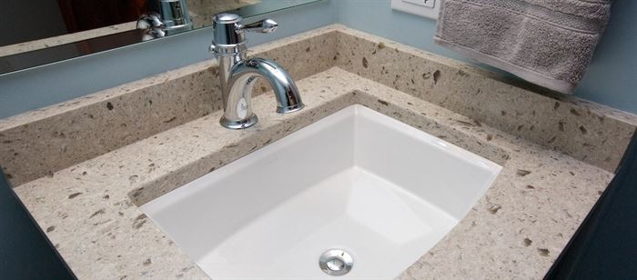 Bathroom sink with silver faucet