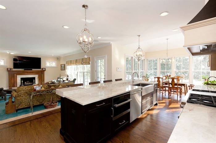 open concept kitchen, living room, dining room with kitchen island in the center